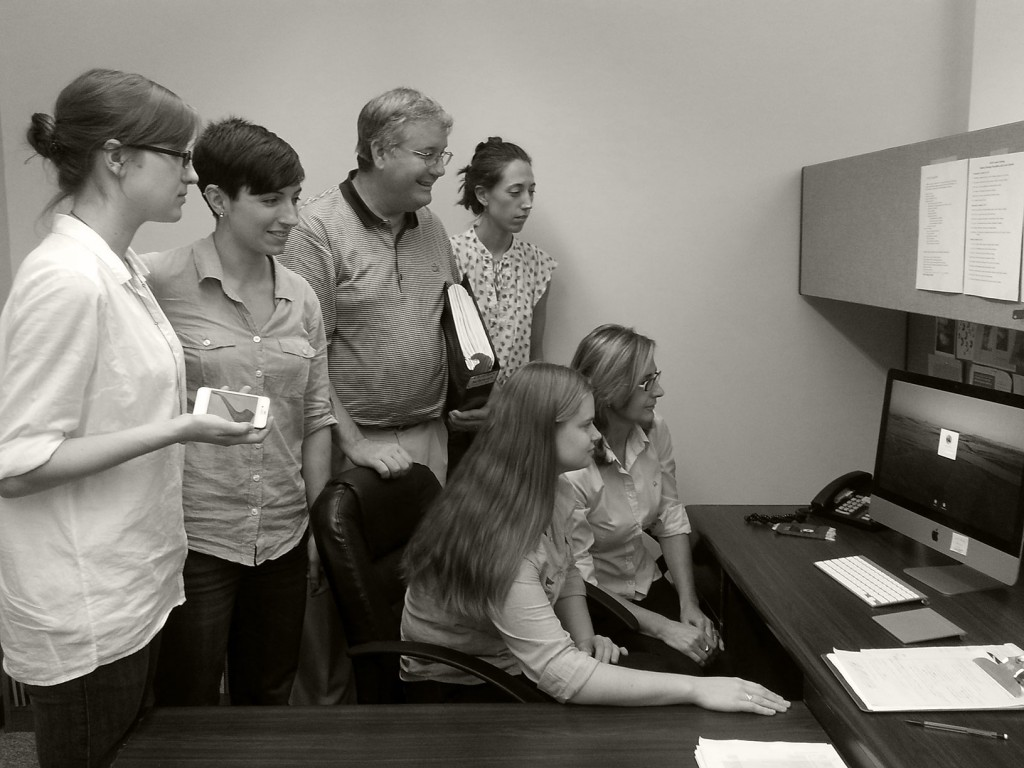 Members of the 2013 ASOR staff recreate the 1986 photo of staff welcoming the new computer system.