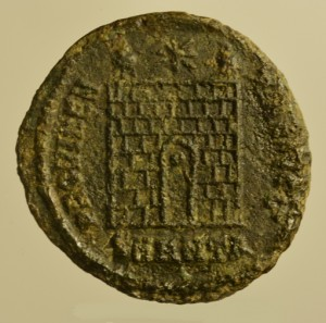 Coin of Constantine I from Tomb B11, showing the gate of a military camp with two towers and a star. 'SMANTA' at the bottom of the inscription stands for 'Sacred (imperial) mint of Antioch, officina A'. 326–327 CE.