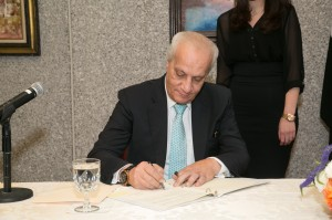 Dr. Mohamed Ibrahim, Minister of State for Antiquities signing the agreement.