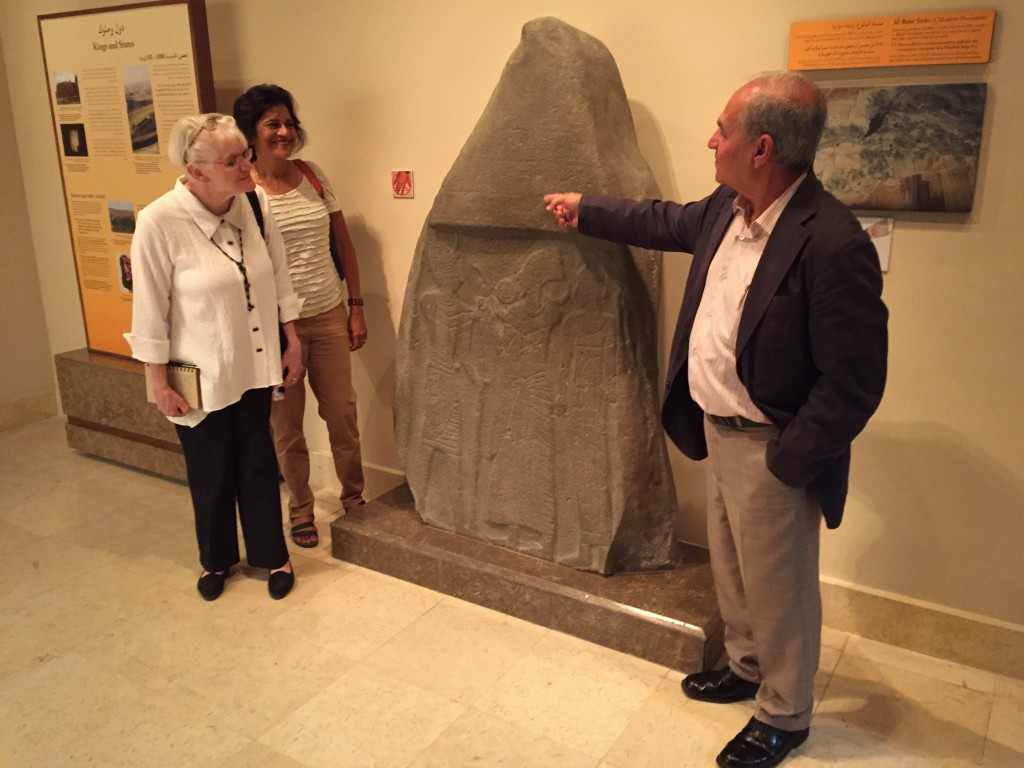 Susan Ackerman, Alina Levy, and Mohammad Najjar view the Balu'a Stele at the Jordan Museum